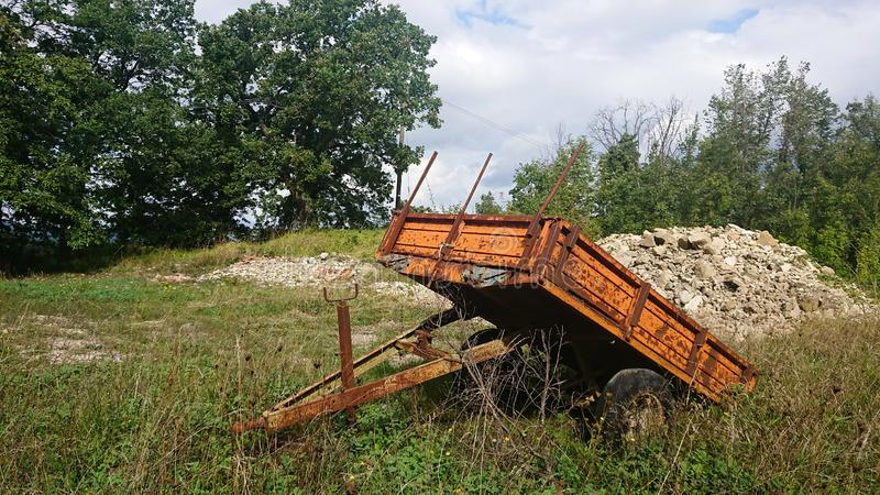 Old farmers trailer. An old trailer used to collect and transport stones from a field after the soil has been turned before planting royalty free stock photography