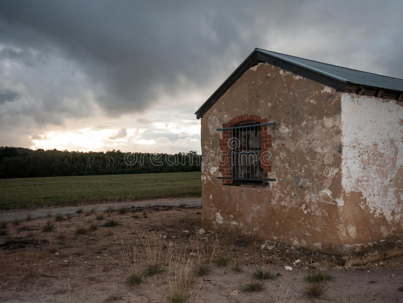 Old farmhouse building at dusk royalty free stock image
