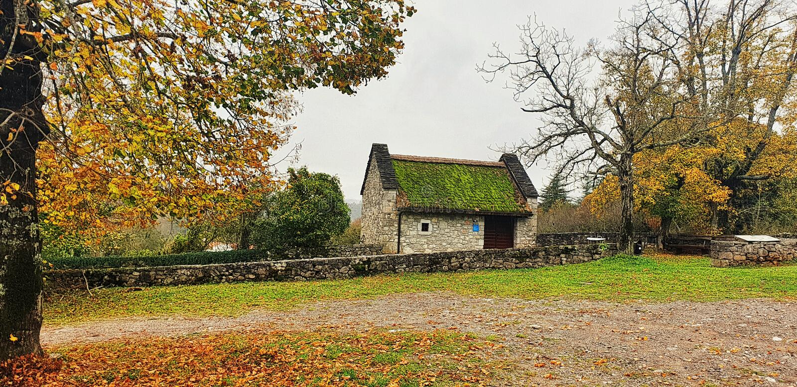 Old farmhouse from medieval times in the fall royalty free stock images