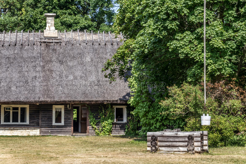 Old Farmhouse and Sweep Well stock image