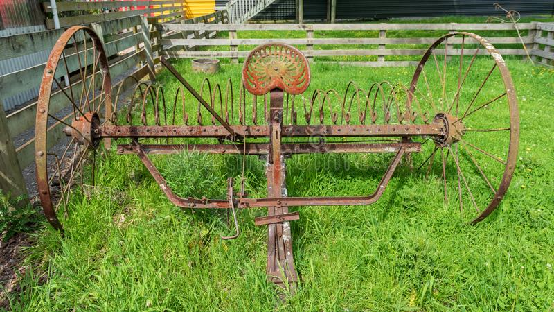 Old farming equipment discarded and unused royalty free stock image