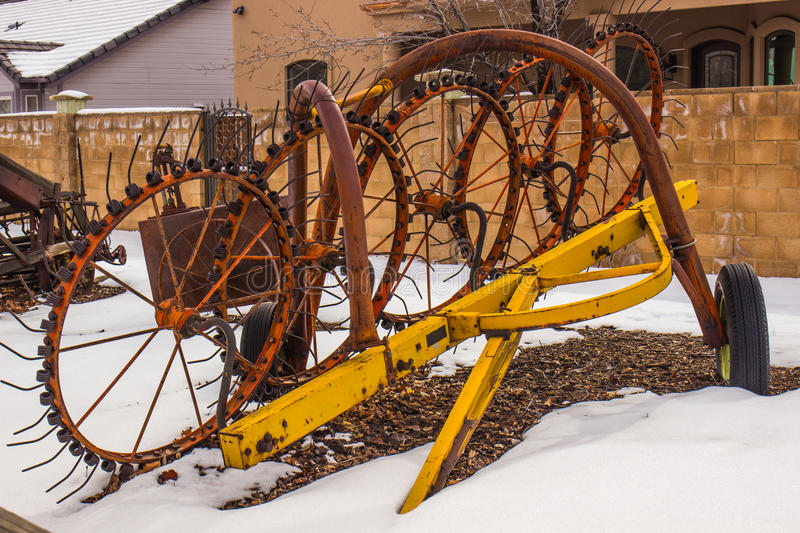 Old Farming Equipment In Winter stock photography