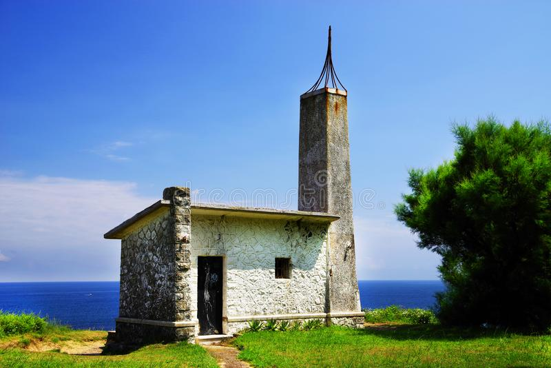 Old faro on cantabrian coast. Ancient lighthouse out of use on the Cantabrian coast, Spain, europe royalty free stock photo