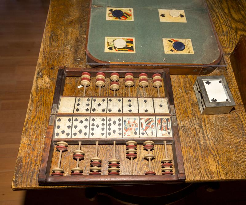 Old fashined card game with pegs. And abacus royalty free stock photos