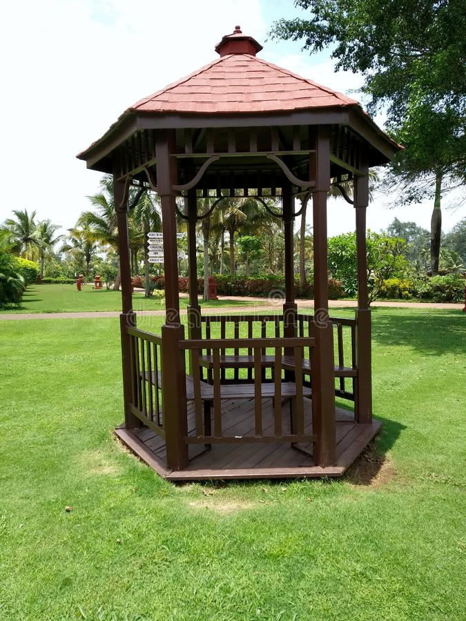 Old fashion gazebo for outdoor concept of home, picnic, or pleasant gathering area.Gazebo in garden. Gazebo in landscaped garden with interlocking stone patio royalty free stock photo