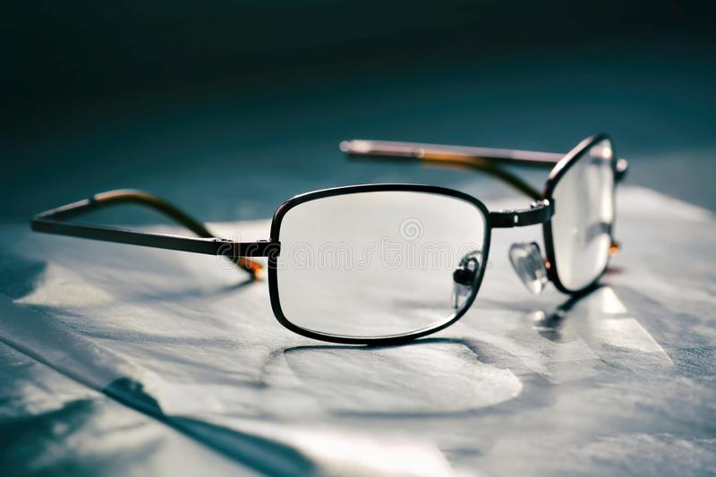 Old fashion glasses. On a table stock photo