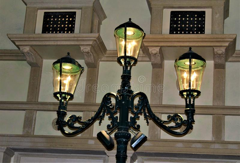 Old Fashion Lamp Post Lite. Old fashion black lite street lamp post with a warm glow stock images
