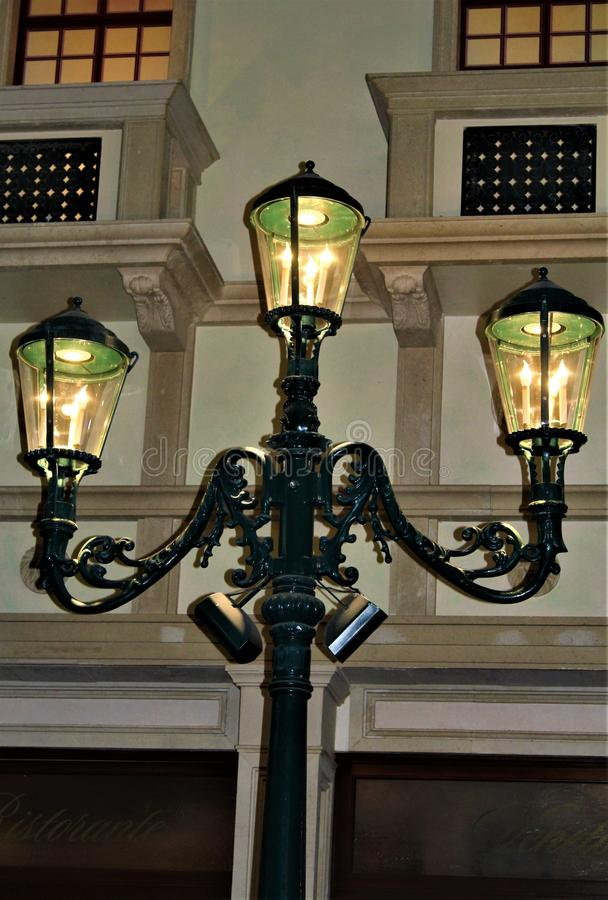 Old Fashion Lamp Post Lite. Old fashion black lite street lamp post with a warm glow stock photography