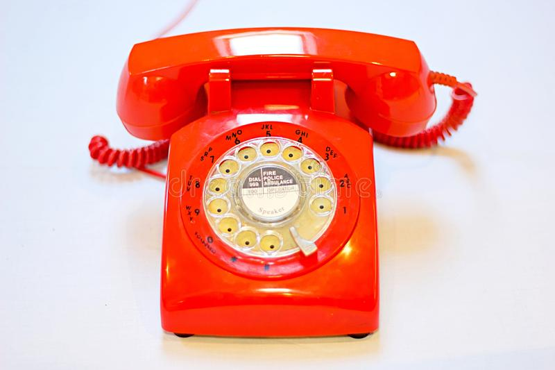 Old fashion rotary dial phone on white background royalty free stock photos