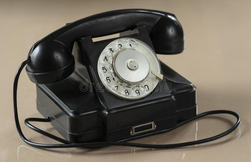 Old Fashion Rotary Dialer Telephone. On The Table stock images