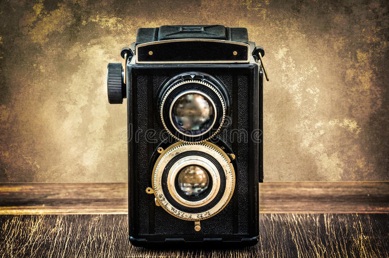 Old fashioned antique camera in vintage style stock image
