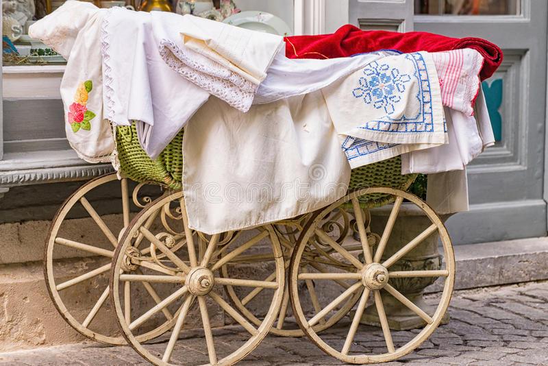 Old-fashioned baby carriage with wooden wheels stock photo