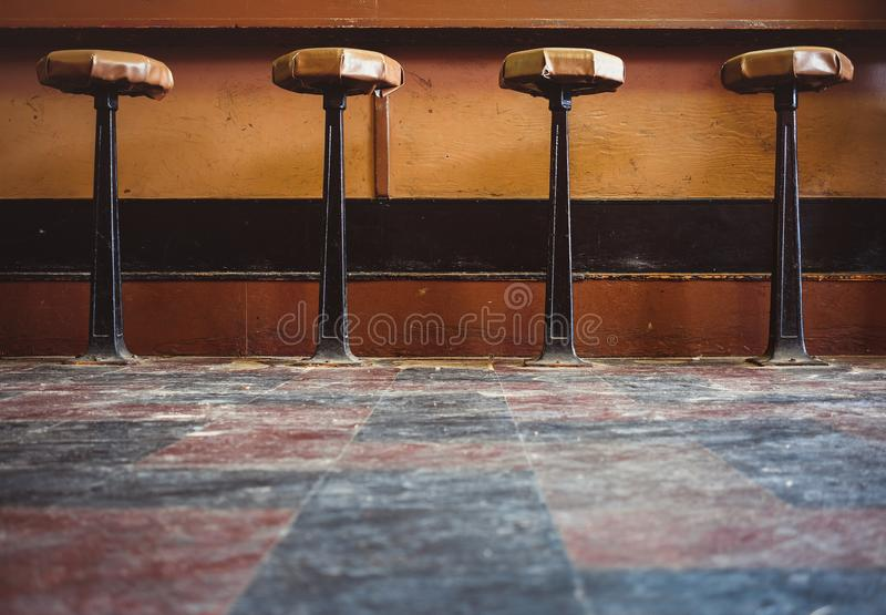 Old fashioned bar stools in a diner. Vintage royalty free stock image