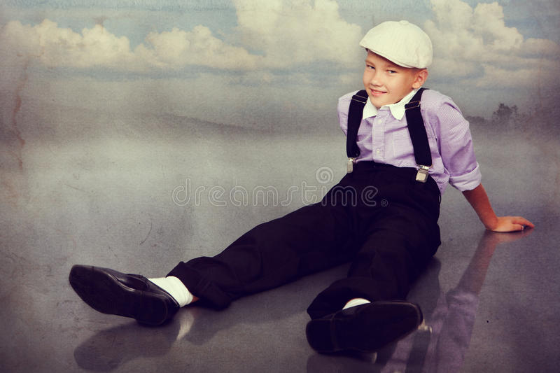 Old fashioned boy looking to the camera stock images
