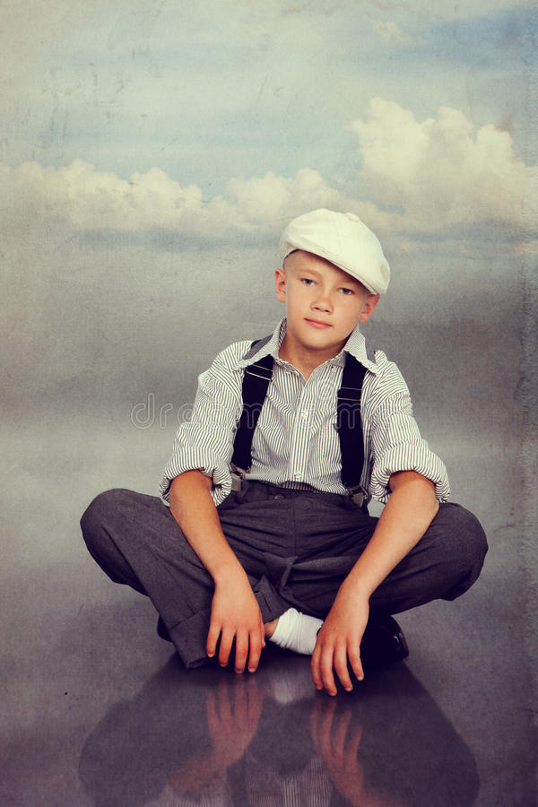 Old fashioned boy looking to the camera royalty free stock photo