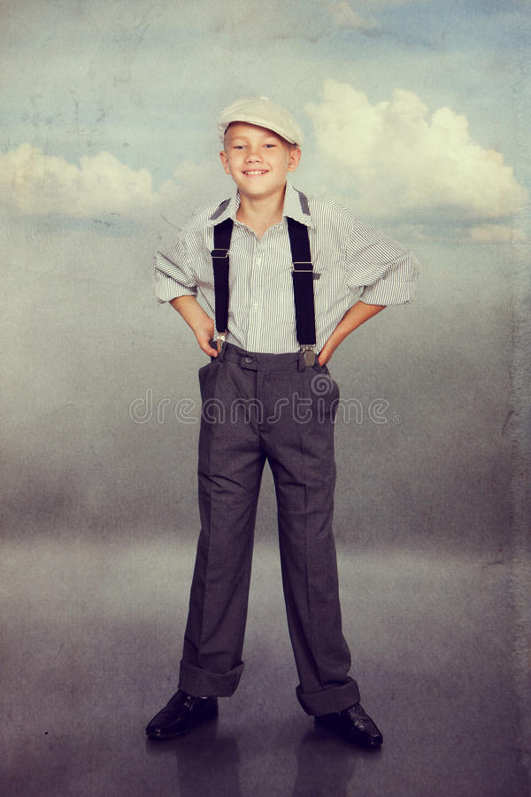 Old fashioned boy looking to the camera stock photography