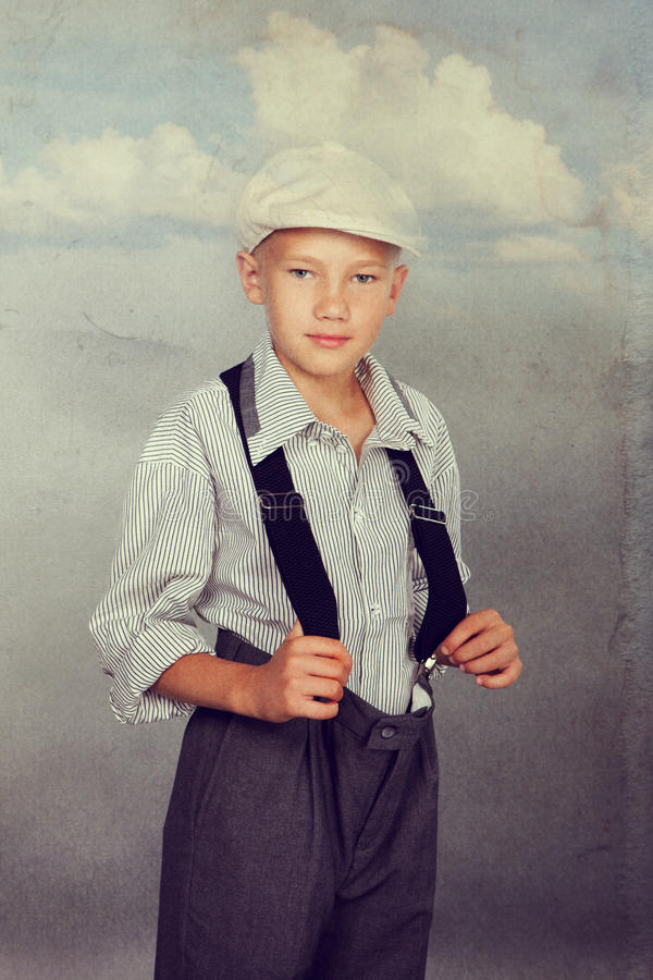 Old fashioned boy looking to the camera royalty free stock image