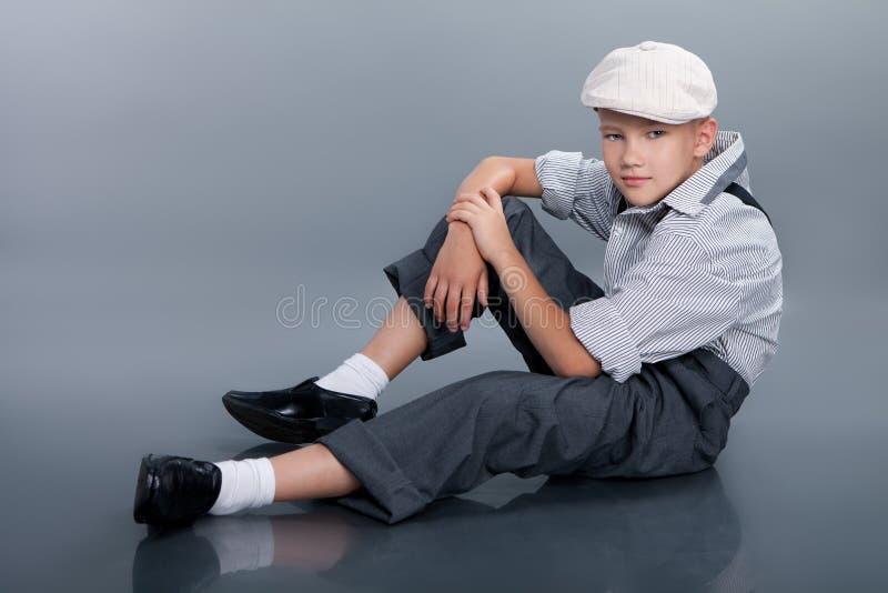 Old fashioned boy sitting stock photos