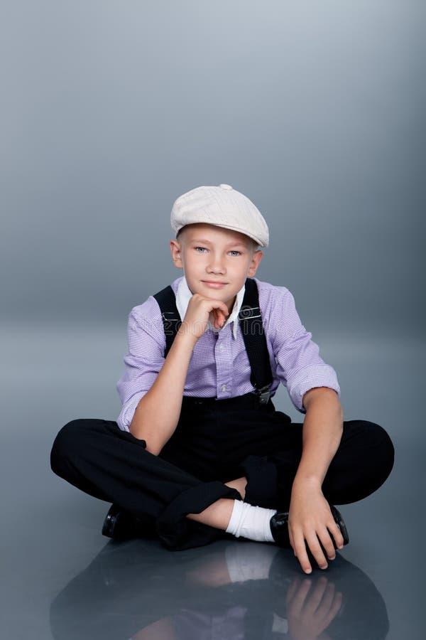 Old fashioned boy sitting royalty free stock photo