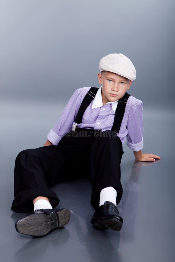 Old fashioned boy sitting royalty free stock image