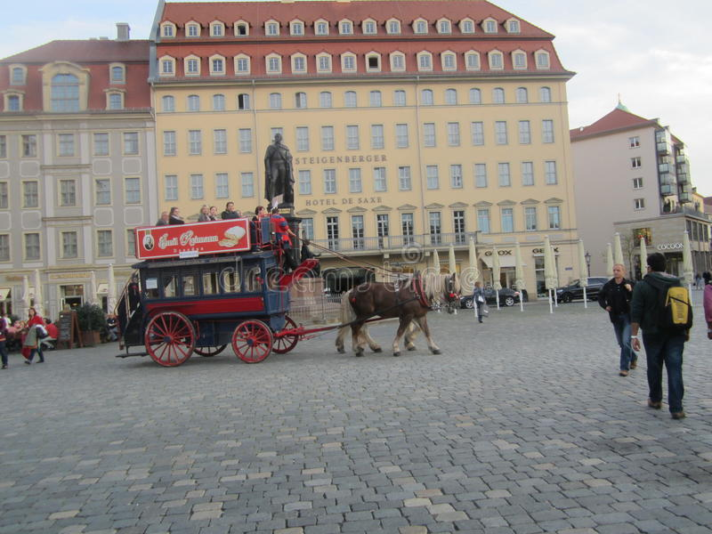 The old-fashioned bus with horse in Dresden, Germany stock photography