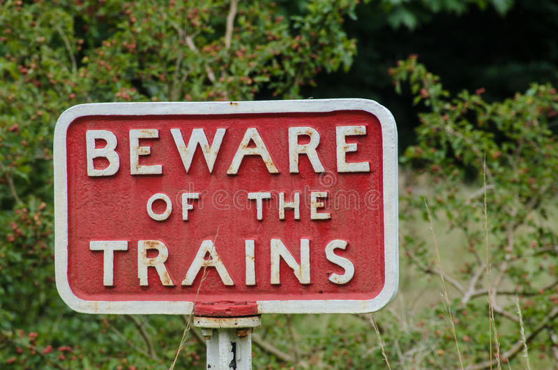 Old fashioned cast iron Beware of Trains sign royalty free stock photos