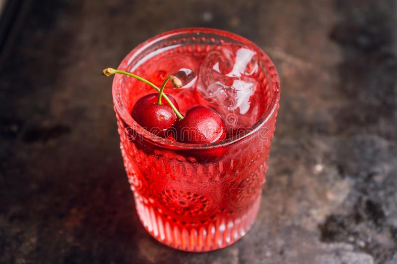 Old fashioned cherry cocktail stock image