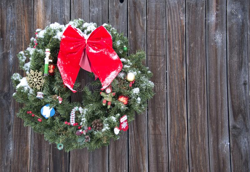 Old fashioned Christmas wreath western style rustic wreath on wood background. Old fashioned Christmas wreath western style wreath on old natural rustic wood royalty free stock image