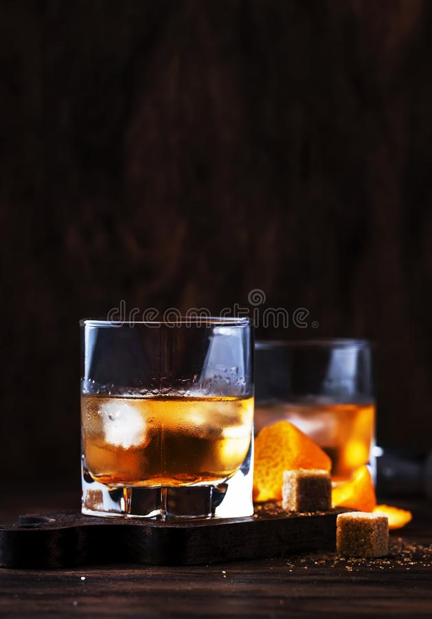 Old Fashioned - classic alcoholic cocktail with bourbon whiskey, bitter, cane sugar and ice in retro glasses on vintage bar stock photos