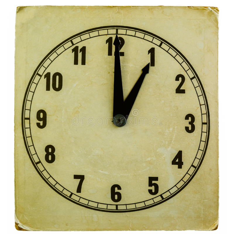 Old fashioned clock showing one oclock. Old fashioned paper clock showing one oclock pm isolated on white royalty free stock image