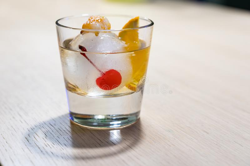Old Fashioned cocktail on ice ball with burning sugar stock photos