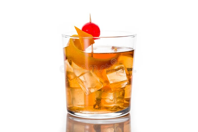 Old fashioned cocktail with orange and cherry isolated on white background. stock photography