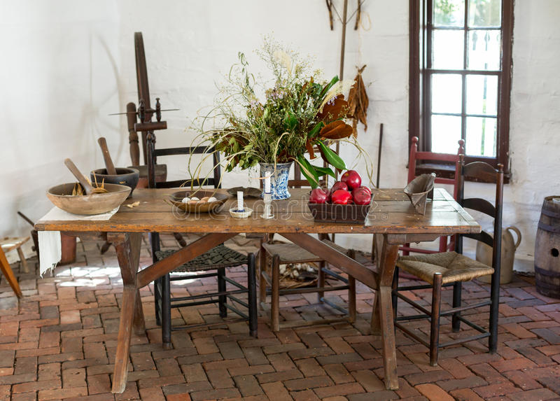 Old fashioned colonial kitchen table royalty free stock photography
