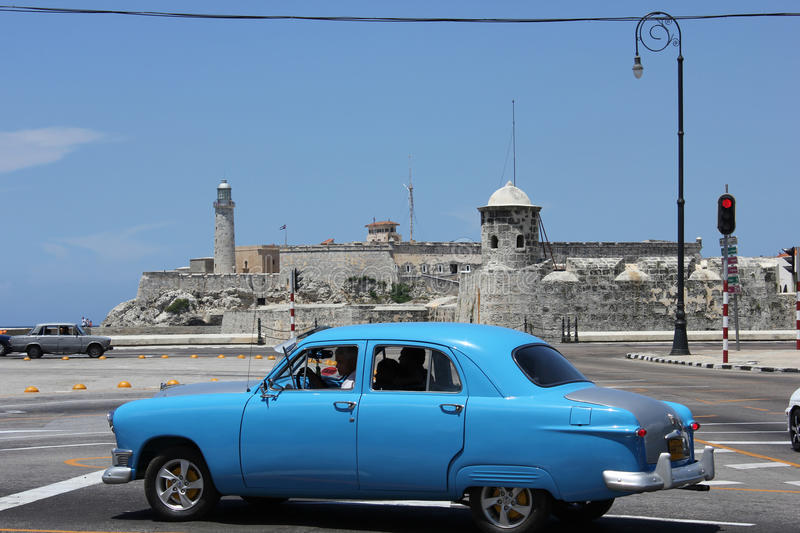 Old fashioned Cuban car and the Castle of the Royal Force, Havana stock photos