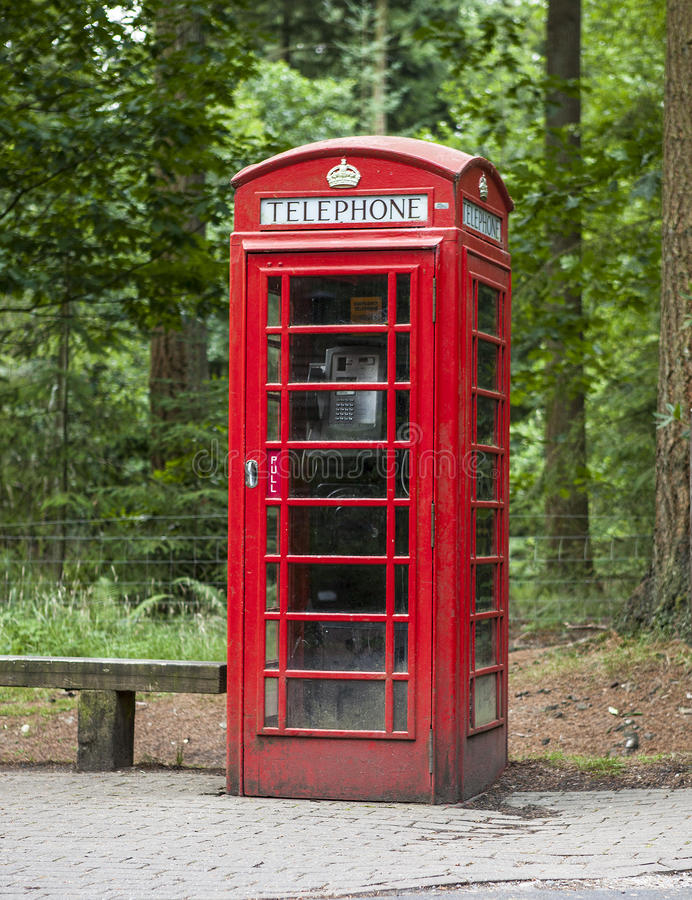 Old fashioned dusty and weathered british phone box royalty free stock photography