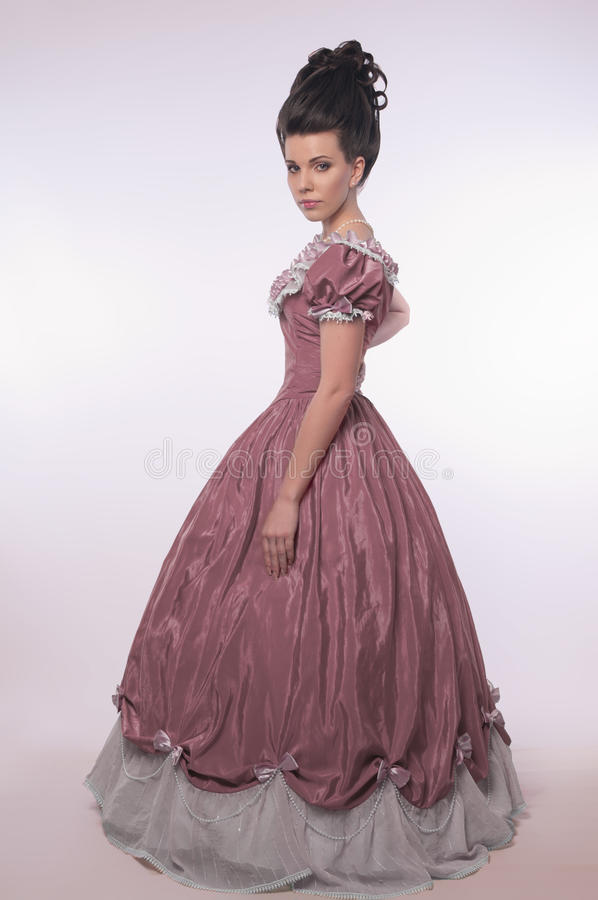 Old fashioned girl in beautifull dress stock photography
