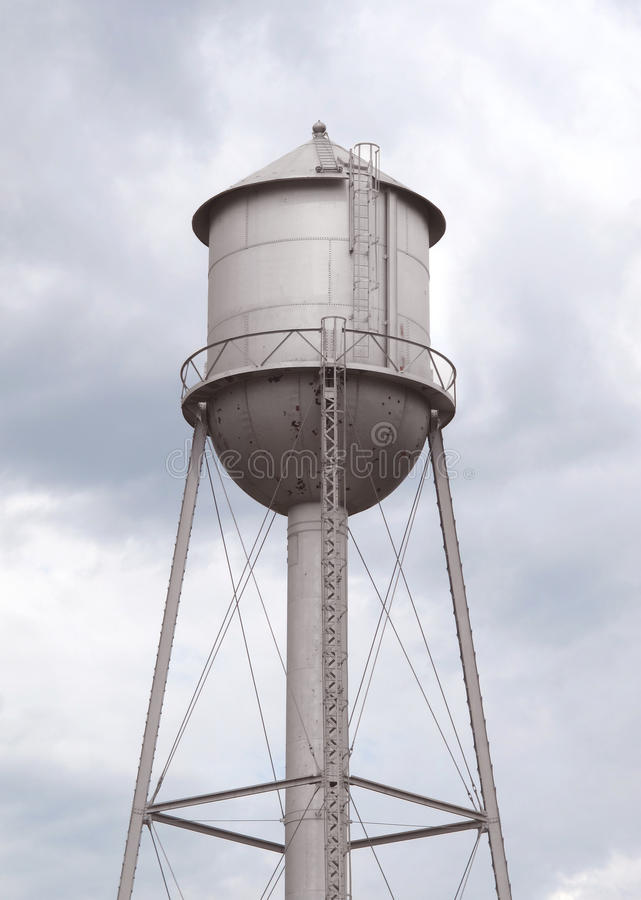 Old fashioned gray metal water tower