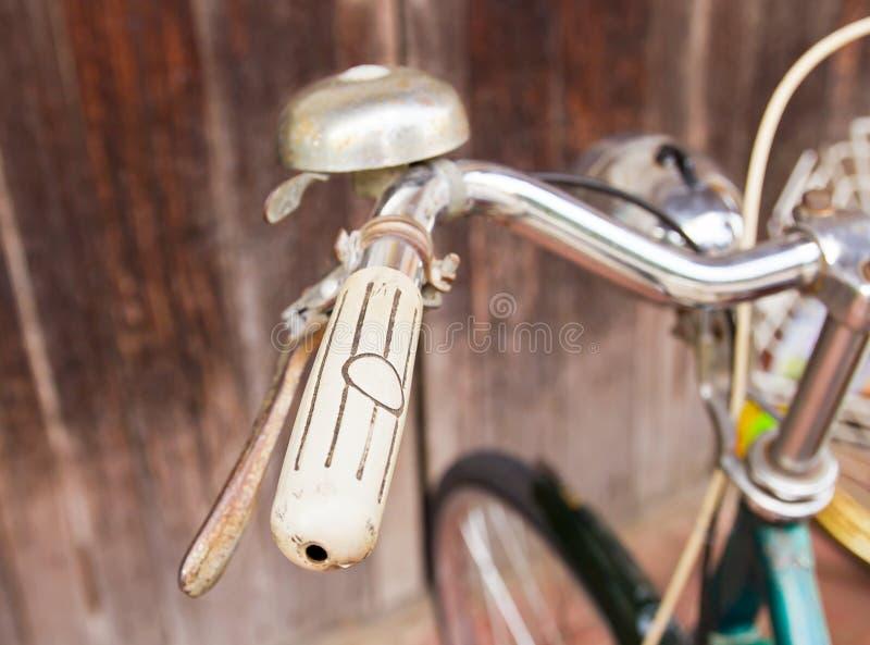 Old-fashioned green vintage bike handlebars stock photo