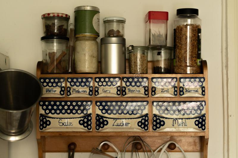 Old fashioned herb and spice rack. On the wall stock images