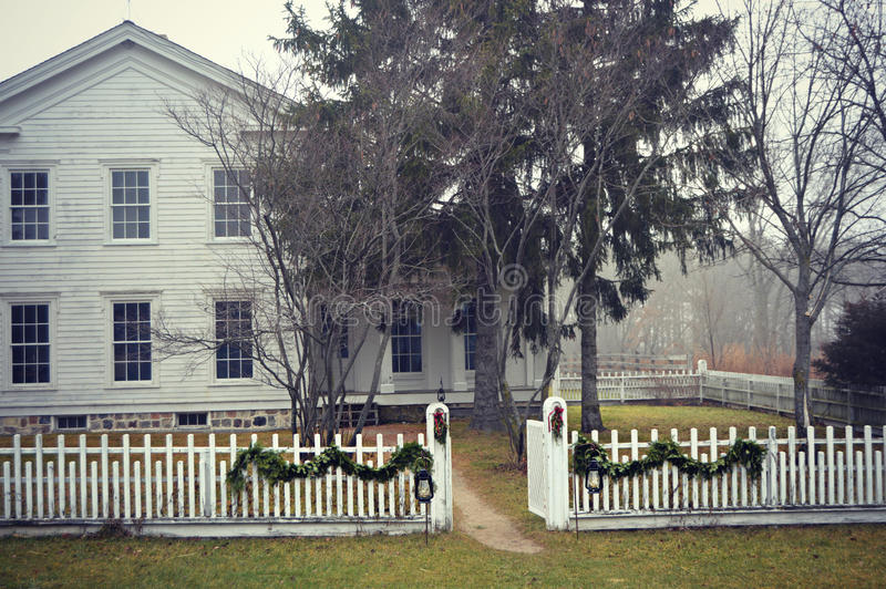 Old Fashioned House with White Picket Fence stock photo