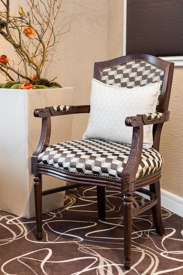 Old fashioned luxurious armchair with squared upholstery royalty free stock images