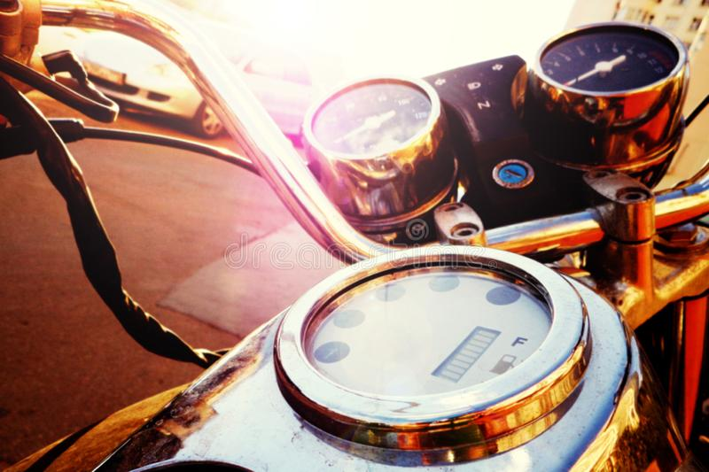 Old fashioned motorcycle with handlebar and dashboard in sun glare, tinted stock photos