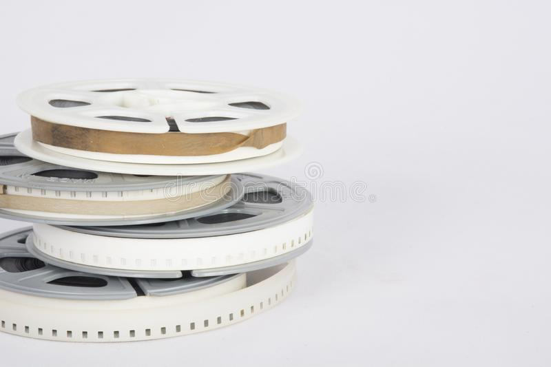 Old fashioned movie film on reels stock photography