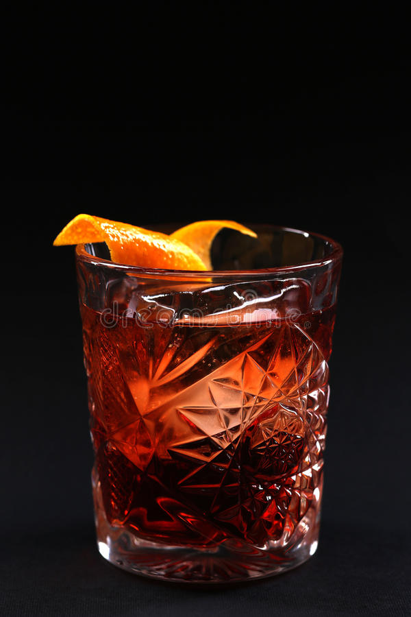 Old fashioned Negroni cocktail on the black background. royalty free stock photo