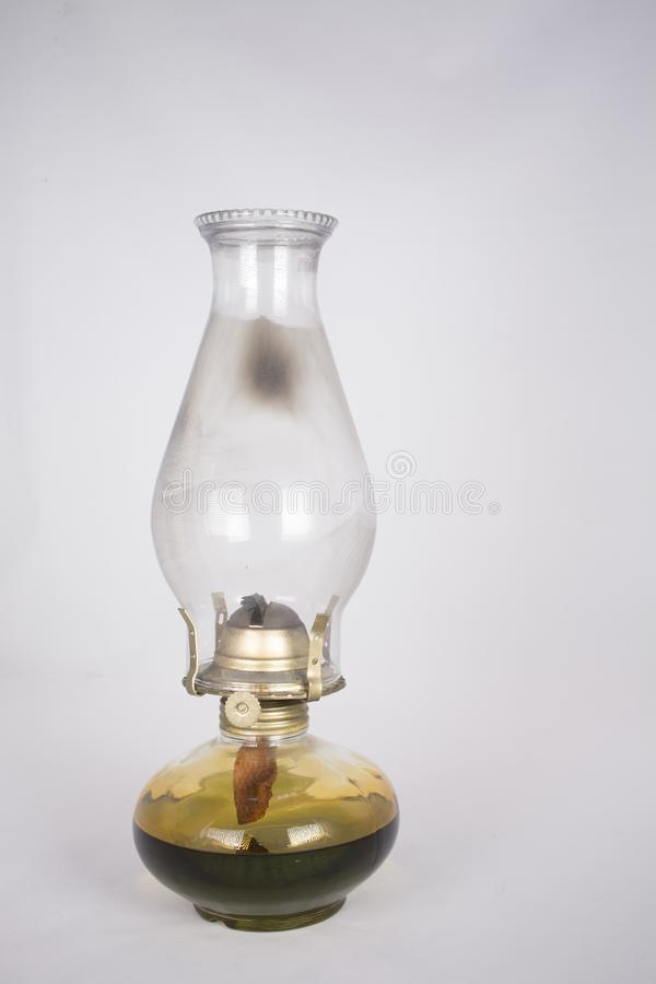 Used oil lamp on white royalty free stock photo