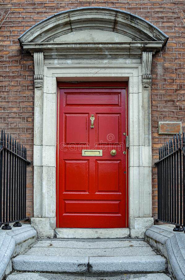 Old-fashioned red door in London, UK stock photos