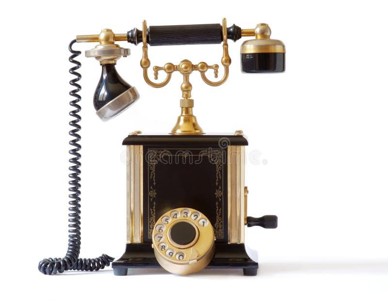 Old fashioned telephone. On white background royalty free stock image