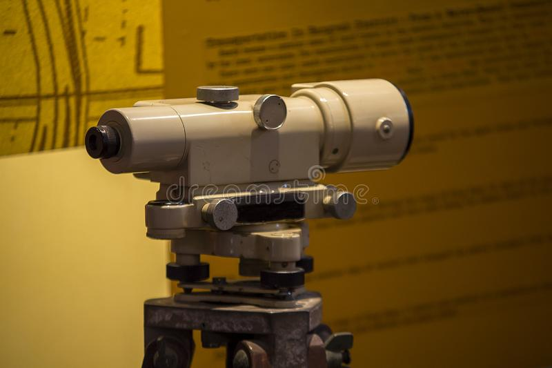 Old-fashioned theodolite camera used to explore the land. The old-fashioned theodolite camera used to survey land and road stock photography