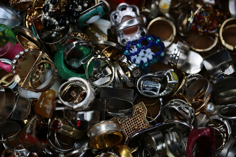 Old-fashioned used finger-rings piled together stock photo