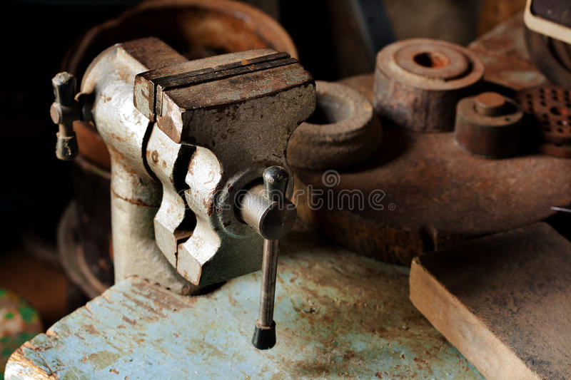 Old fashioned used vice in maintenance room royalty free stock photography